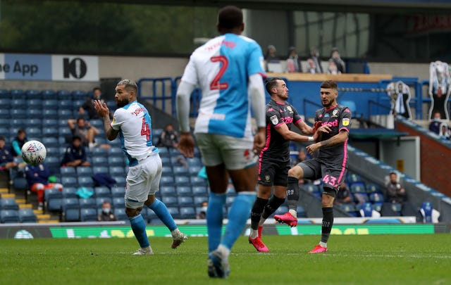 Mateusz Klich (right) scores his side's third goal (