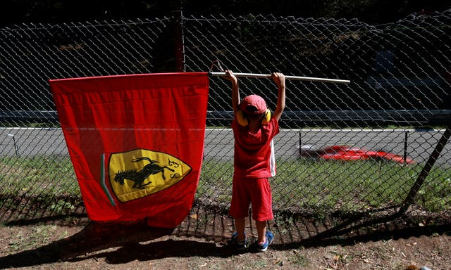 A young Ferrari fan watches the action during the 2015 Italian Grand Prix at Monza. The Italian team were unable to claim victory on home soil as eventual world champion Lewis Hamilton, racing for Mercedes, took the chequered flag ahead of Ferrari's German driver Sebastian Vettel