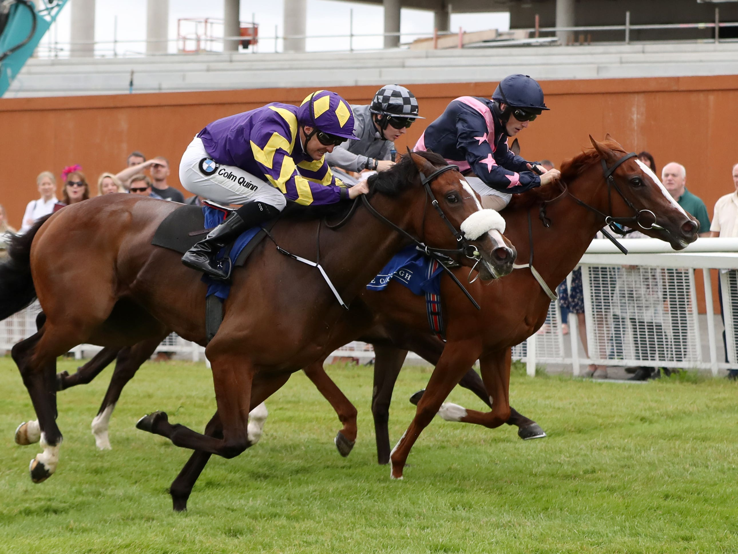 Chocolate Music (left) gains a narrow victory at the Curragh (Niall Carson/PA)