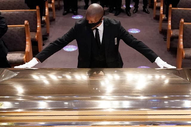 George Floyd's coffin is placed in the chapel at the Fountain of Praise church
