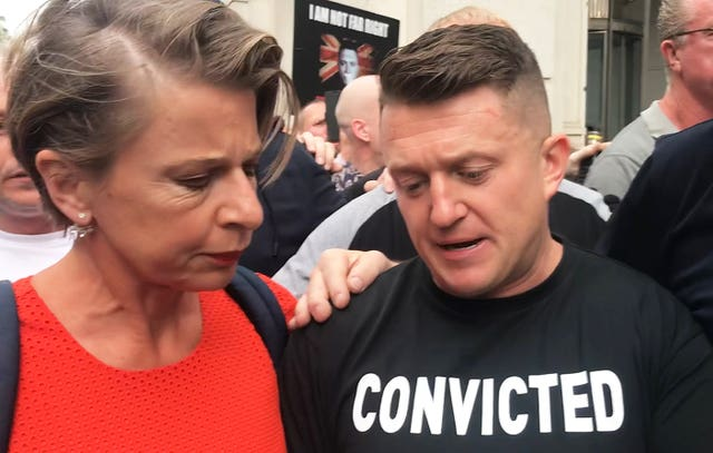 Tommy Robinson with Katy Hopkins as he arrives for his sentencing at the Old Bailey