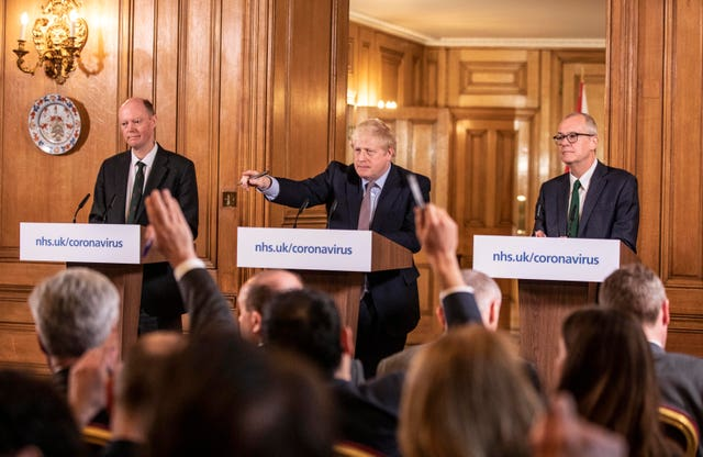 Chief medical officer Chris Whitty, Boris Johnson and chief scientific adviser Sir Patrick Vallance during Monday's briefing (Richard Pohle/The Times)