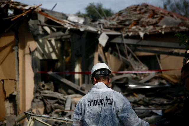 The damage to a house hit by a rocket in Mishmeret, central Israel