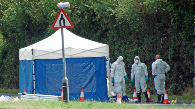 Forensic officers at work at the scene of the suspected hit-and-run in Cheltenham (Rod Minchin/PA)