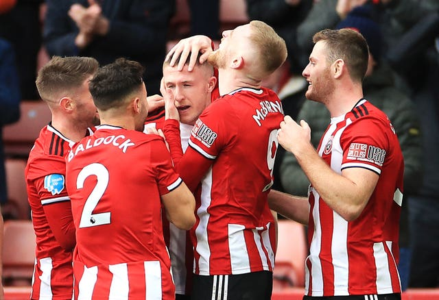 John Lundstram celebrates firing flying Sheffield United to a 2-1 comeback win against Bournemouth