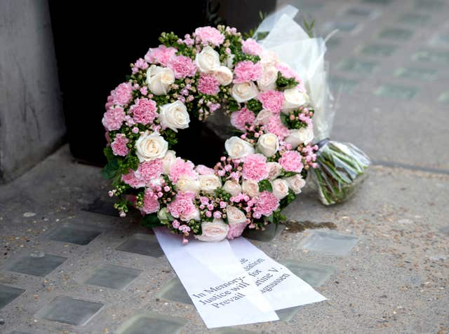 A floral tribute left by Mr Magnussen in Great Portland Street (David Mirzoeff/PA)