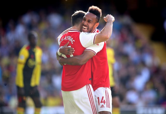 Pierre-Emerick Aubameyang, right, celerates with Sead Kolasinac after his first goal against Watford