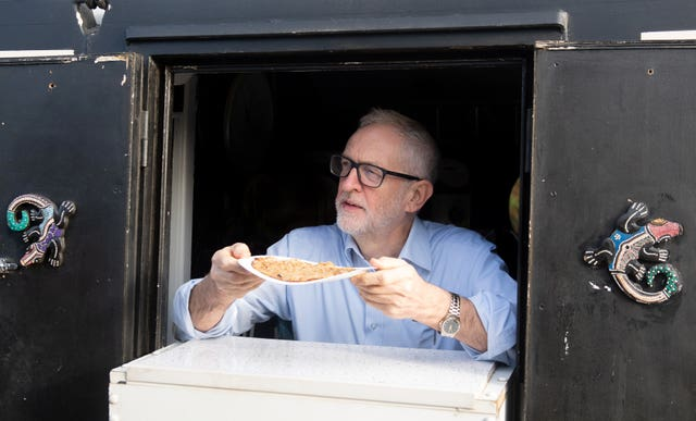Jeremy Corbyn serves oatcakes during a visit to The Oatcake Boat owned by Kay Mundy, in Stoke-on-Trent