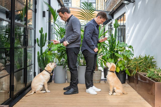 Ant and Dec with the puppies named after them