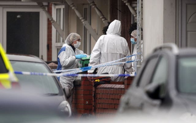 Forensic officers at the scene of the incident