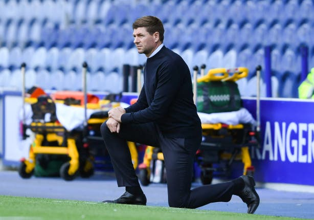 Rangers manager Steven Gerrard takes a knee ahead of the match against St MIrren