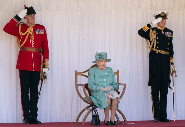 The Queen watching last year's military ceremony that marked her official birthday