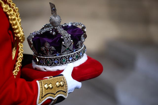The Imperial State Crown is carried through the Sovereign's entrance