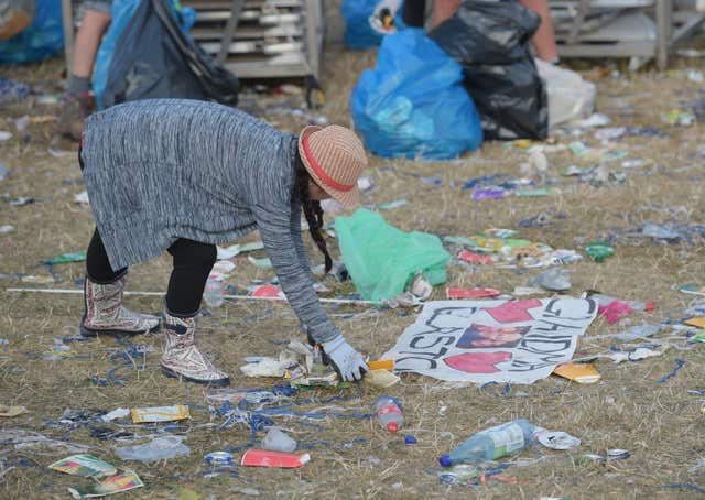 Rubbish is collected following the Glastonbury Festival (Ben Birchall/PA)