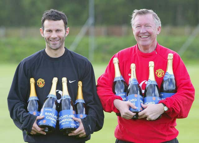 Ryan Giggs and Sir Alex Ferguson celebrate an eighth title of the Premier League era.