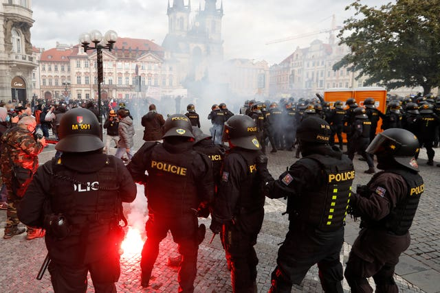 Police confront demonstrators in Old Town Square in Prague