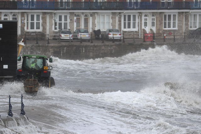 A tractor puts in temporary flood defences in Swanage in Dorset in October