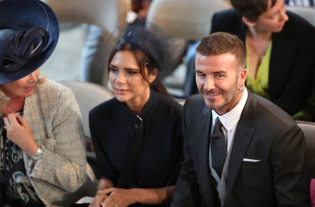 David and Victoria Beckham take their seats in St George's Chapel (Danny Lawson/PA)