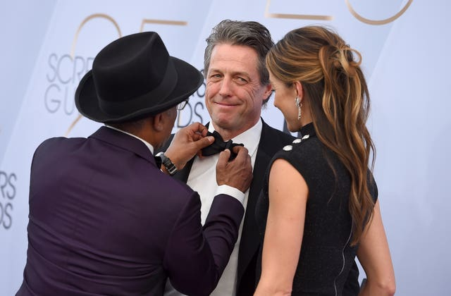 Giancarlo Esposito, from left, Hugh Grant, and Anna Elisabet Eberstein arrive at the 25th annual Screen Actors Guild Awards