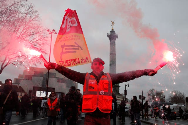Strikers march on the Place de la Bastille during a demonstration in Paris