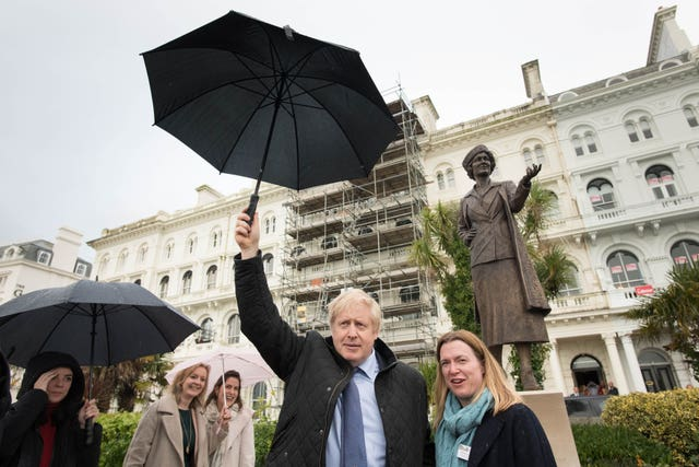 Boris Johnson joins Plymouth parliamentary candidate Rebecca Smith at the statue whilst on the campaign trail (Stefan Rousseau/PA)