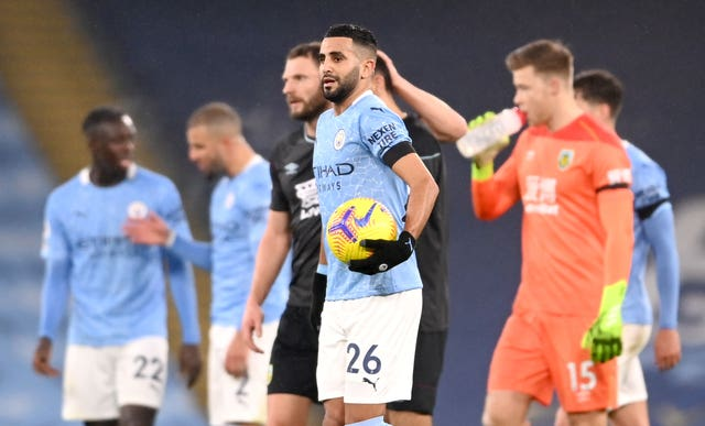 Riyad Mahrez, centre, with the match ball after his hat-trick against Burnley