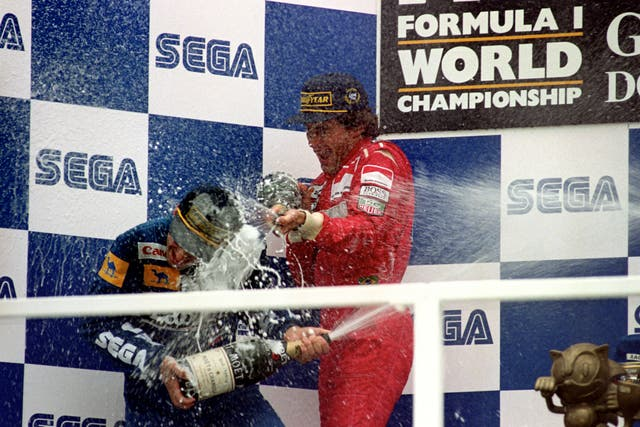 Ayrton Senna (right) sprays champagne over Damon Hill