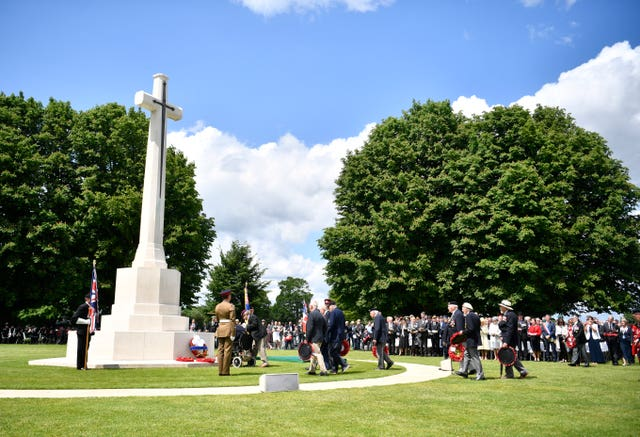 Veterans lay wreaths at the Commonwealth War Graves Commission Cemetery in Bayeux