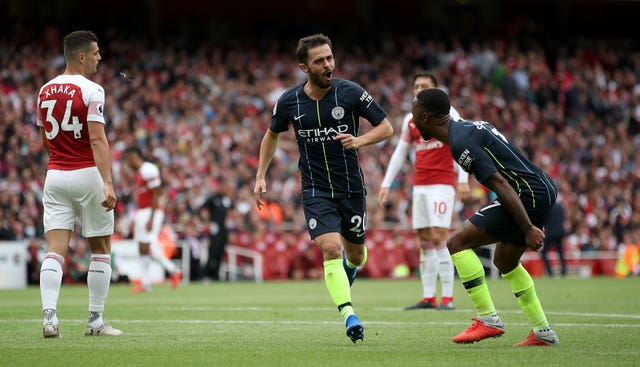 Bernardo Silva celebrates his goal with Raheem Sterling