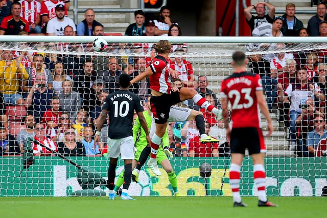 Jannik Vestergaard, second left, heads Southampton's equaliser