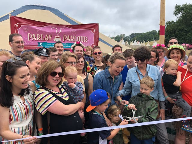 Emily Eavis, centre, opening the new Parlay Parlour in The Park on the first day of the Glastonbury Festival at Worthy Farm in Somerset