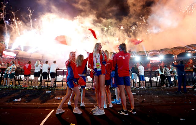 Isle of Man athletes wave flags in the closing ceremony in Australia's Gold Coast (Martin Rickett/PA)