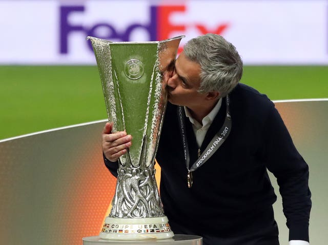 Mourinho kisses the trophy after winning the UEFA Europa League Final against Ajax in May 2017