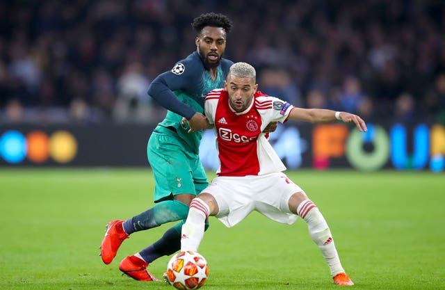 Hakim Ziyech competes with Tottenham's Danny Rose in the Champions League last season