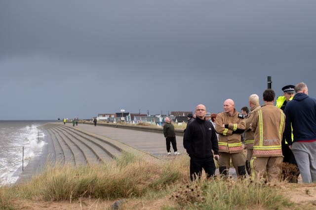 Police and fire service monitor water levels at Heacham Beach in Norfolk