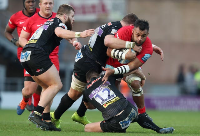 Saracens' Billy Vunipola is tackled by Exeter's Dave Ewers and Ollie Devoto