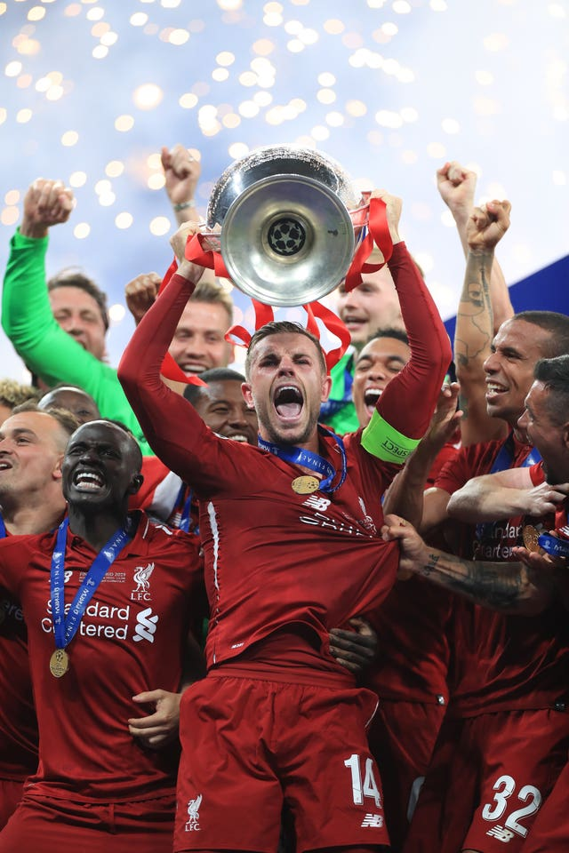 Liverpool captain Jordan Henderson lifts the Champions League trophy after his side shrugged of the disappointment of finishing second in the Premier League to win the club's fifth European cup. Goals from Mohamed Salah and Divock Origi secured a 2-0 success over Tottenham on June 1 at Atletico Madrid's Wanda Metropolitano stadium
