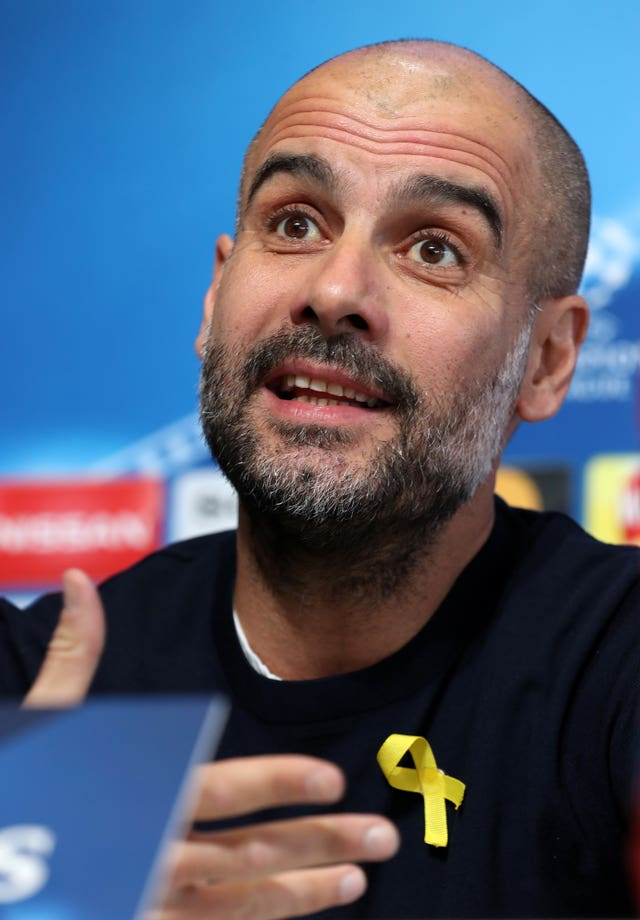 Pep Guardiola wearing a yellow ribbon in support of Catalan independence