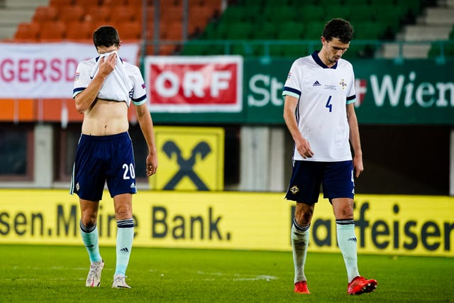 Northern Ireland's Craig Cathcart (left) and Tom Flanagan reflect on another painful defeat
