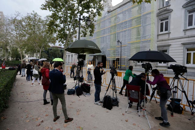 Journalists waiting outside the court