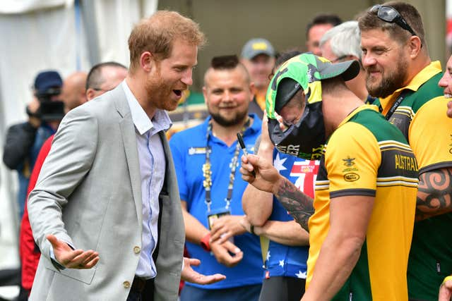 The Duke of Sussex shares a joke with an Australian competitor