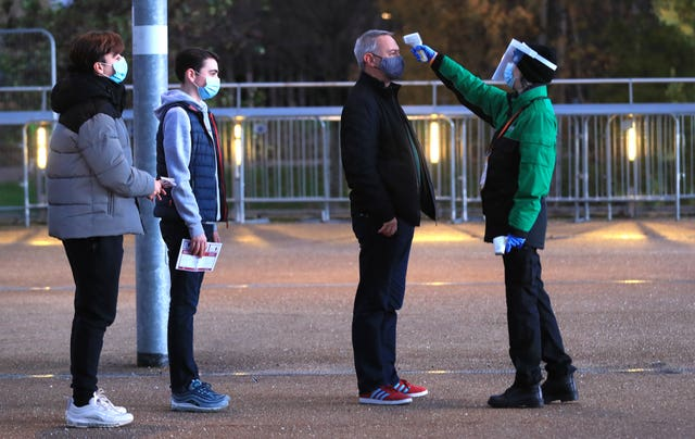 West Ham fans have their temperature taken as they arrive at the London Stadium for the match with Manchester United