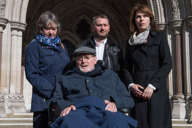 Terminally-ill retired lecturer Noel Conway, 68, with his wife Carol (left), stepson Terry McCusker (centre back) and Sarah Wootton, CEO of Dignity in Dying outside High Court in London. Stefan Rousseau/PA