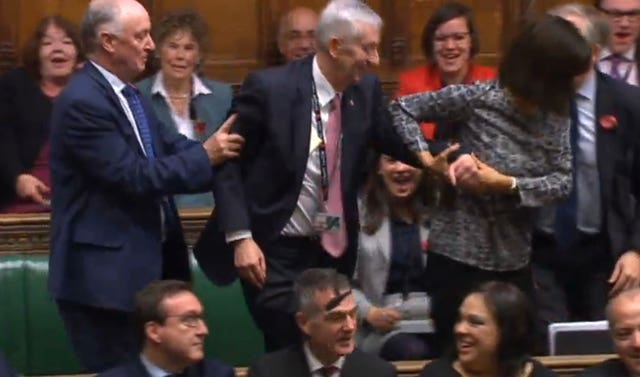 Sir Lindsay Hoyle (centre) is dragged to the speaker's chair