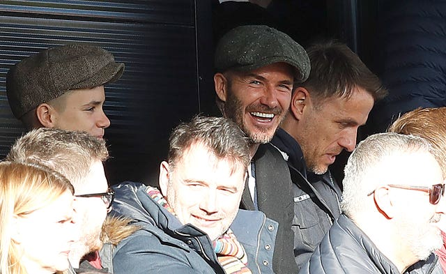 David Beckham, centre, was joined by son Romeo, left, for Salford's game (Martin Rickett/PA)