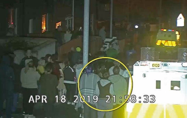 CCTV image of Lyra McKee (circled) within the crowd watching a protest in Londonderry before she was shot