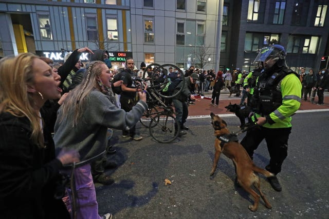Police dogs were deployed on Sunday (Andrew Matthews/PA)