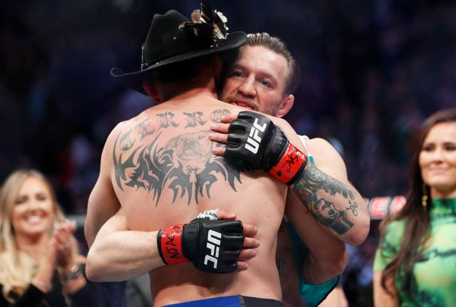 McGregor and Cerrone embraced afterwards, underlining the mutual respect between the pair (John Locher/AP)