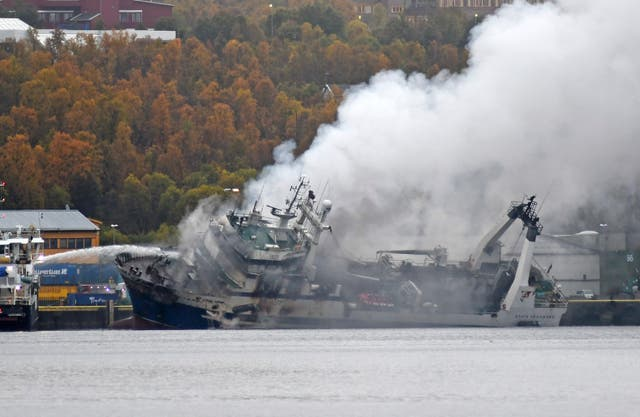 The Russian fishing trawler Bukhta Naezdnik engulfed in smoke in the harbour of Tromso, Norway