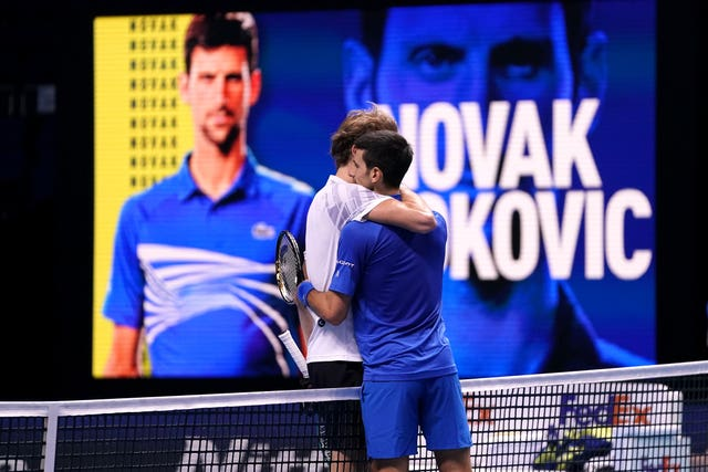 Novak Djokovic (right) embraces Alexander Zverev after their clash at The O2